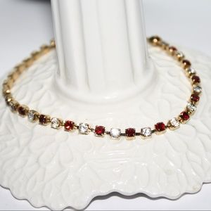 Avon 8 inch gold red and cz bracelet